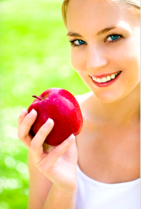 Healthy Holistic Dental Girl with Apple